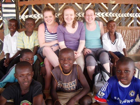 The girls surrounded by the local footballers