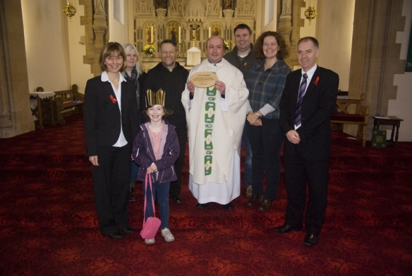 From left to right: Rosa Trelfa, Maggie McSherry,Abigail, Paul Kelly, Fr John Winstanley, Gerard Maloney, Mary Whittle and Patrick Gardner