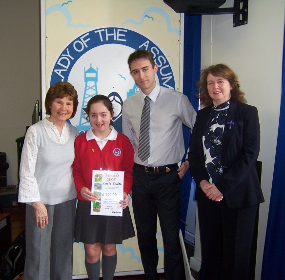 Lucie, with Kathy Smith, her granny, and Mr Williams her class teacher and Miss Heggarty