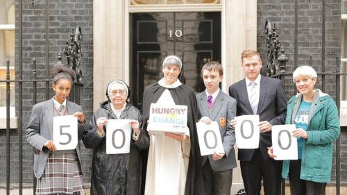 Hungry-for-change-50000-action-cards-hand-in-at-downing-street_layout-large