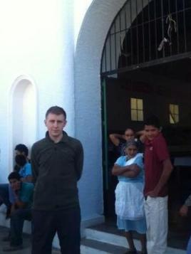 James outside church in Arcatao