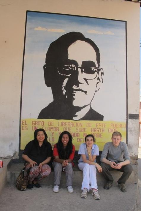 James with his fellow gappers in front of a mural of Romero