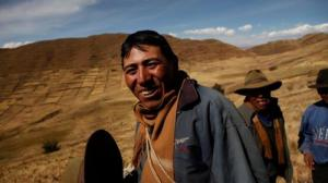 Antonio, a farmer Bolivia, is bringing water for livestock down from the mountains as wells dry up due to the climate getting hotter.