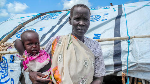 South Sudan: Bibiana Okong in front of tent