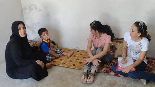 A mother and her three children who had to flee their home in Iraq because of the violence.