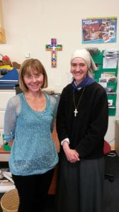 Elizabeth visited the CAFOD office in Preston in June. How apt is the Romero Cross on the wall behind us! Painted by a family in El Salvador - vibrant in colour