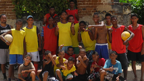 Rodrigo and his friends are able to escape violence in their community by playing football with Growing Towards Peace in Brazil.