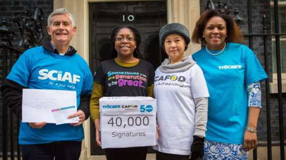 Supporters from CAFOD, Trocaire and SCIAF present your 40,000 signature to Number 10 Downing Street.