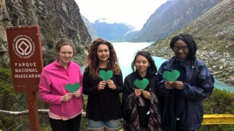 CAFOD Step into the Gap Volunteers, holding green hearts, in Peru.
