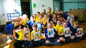 Children learning about the world with CAFOD in assembly